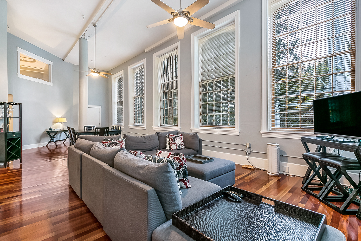 Beautiful 3 bed/2 bath corner unit at the Cotton Mill.  8 tall incredible windows that make this unit extra special bringing in lots of natural light that over looks the courtyard. Tall ceilings, open floor plan, wood floors. Parking included. Big Gym! Pool! 24/7 doorman!